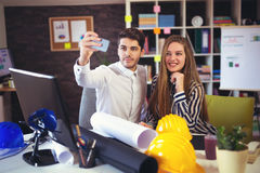 Young architects make selfie photo in office Stock Photography