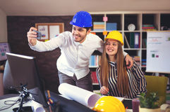 Young architects make selfie photo in office Royalty Free Stock Image
