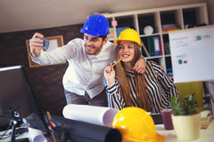 Young architects make selfie photo in office Royalty Free Stock Photo