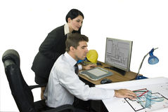 Young architects in office. Two young architects in office  working on a laptop for a graphical construction.Also,check out  Workers and tools Royalty Free Stock Photography