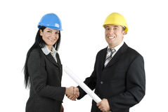 Young architects shaking hands royalty free stock photo