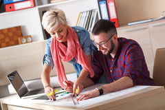 Young architects working on new project in office Stock Image