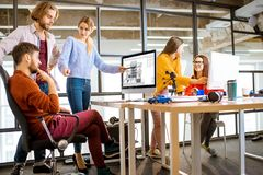 Young architects working in the office royalty free stock image