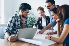 Young architects working on project in office royalty free stock image