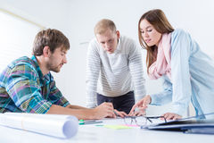 Young architects working together Stock Image