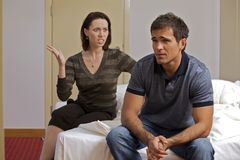 Young arguing with her husband in hotel room Stock Images