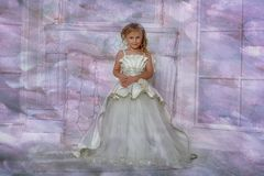 Young aristocrat in a smart white dress. In a Christmas royalty free stock images