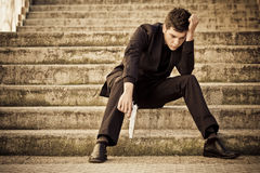 Young armed man on stairs. Young armed elegantly dressed man on stairs stock photo