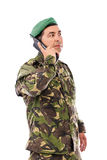 Young army soldier with beret speaking on phone Stock Photo