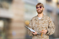 Young army soldier with a clipboard Royalty Free Stock Photography