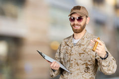 Young army soldier with a clipboard Stock Image