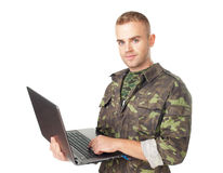 Young army soldier with a laptop Royalty Free Stock Image