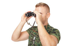 Young army soldier looking through binoculars Stock Image