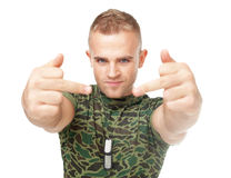 Young army soldier showing the middle fingers Stock Photos