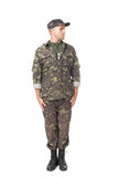 Young army soldier standing in attention Stock Photos