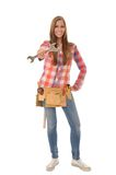 Young artisan shows a wrench. Young attractive artisan proudly displays her wrench Stock Photography