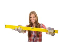 Young artisan and yellow water balance. Attractive young trainees with work gloves shows her bubble level Royalty Free Stock Photo