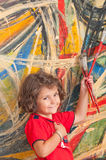 Young Artist. Young girl with a captivating personality in front of an abstract painting stock photos