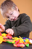 Young Artist. Young cute boy playing with plasticine stock photo