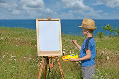 Young artist and blank sheet, outdoor Stock Image