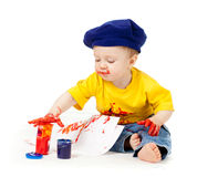 Young artist child with paints. Young artist baby boy with paints Royalty Free Stock Image