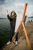 Young artist drawing outdoors Royalty Free Stock Photos