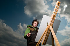 Young artist drawing outdoors Royalty Free Stock Photography