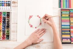 Young artist drawing pattern with watercolor paint and brush Stock Photography