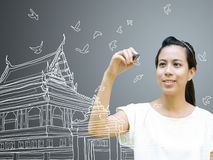 Young artist drawing Thai ancient architecture Royalty Free Stock Images