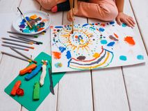 Young artist. Early children education. Unrecognizable artistic child on white background, colorful drawing process. Creative art studio, creativity concept stock images