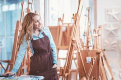 Young artist with easels. In the store stock image