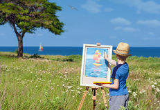Young artist finishing his work, outdoor Stock Photography