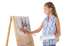 The young artist. The young girl draws on an easel Stock Images