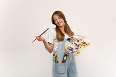 Young artist holding a brush to paint and palette. Stock Images