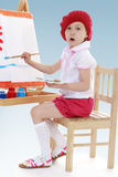 Young artist paint brush on the easel. Stock Photos