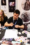 Young artist painting alien portraits. At the East European Comic Con in Bucharest, Romania, Romexpo 2017 Stock Photography