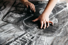 Young artist painting with charcoal Stock Images