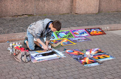 The young artist paints a pictures on a city street Stock Photo