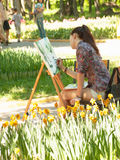 Young artist in park Stock Images