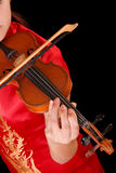 Young artist with play violin on black Stock Photo