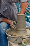 Young artist shaping a clay pot Stock Image