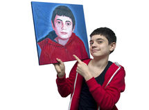 Young artist showing his self portrait Stock Photos