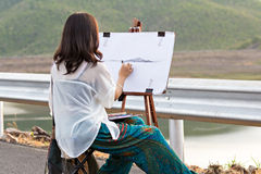 Young artist sketching a landscape Royalty Free Stock Images