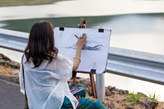 Young artist sketching a landscape Royalty Free Stock Image