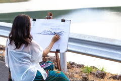 Young artist sketching a landscape Stock Photography