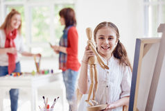 Young artist with Wooden figure Royalty Free Stock Photo