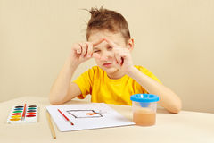 Young artist in yellow shirt painting colors from nature Royalty Free Stock Photography