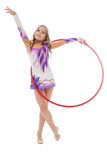Young artistic athlete performs with hula hoop Royalty Free Stock Image