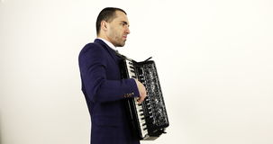 A young artistic musician plays the accordion. stock video