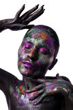 Young artistic woman in black paint and colourful powder. Glowing dark makeup. Creative body art on the theme of space. And stars. Bodypainting project: art stock photo